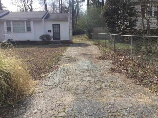 Driveway before exterior renovation house flip raleigh