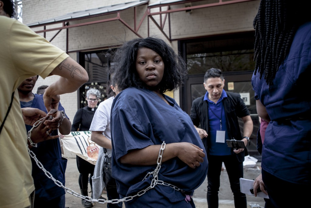 April 3, 2018 - Memphis, TN: Destiny Brown gets ready for the protest at 201 Poplar that was a part of the Rolling Block Party organized by members of C3 coalition, Fight for $15 and Comunidades Unidas en Una Voz (C.U.U.V)Photo by Andrea Morales.