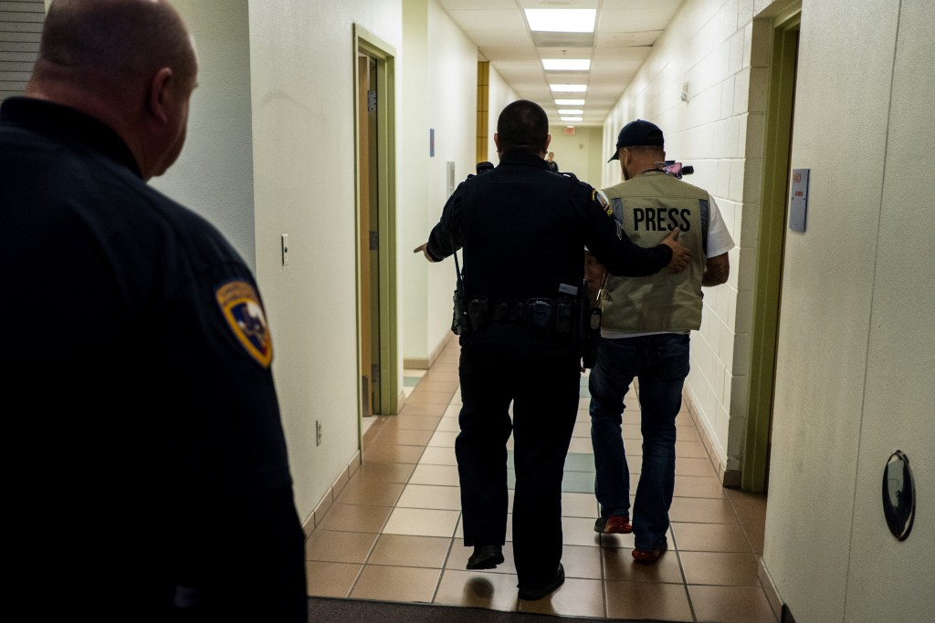 Anthony Aguero is escorted out of a town hall meeting with Congresswoman Veronica Escobar after raising his hand and not being selected to ask a question at Canutillo High School in El Paso, Texas, Saturday, May 11, 2019. (Joel Angel Juárez for The Intercept)