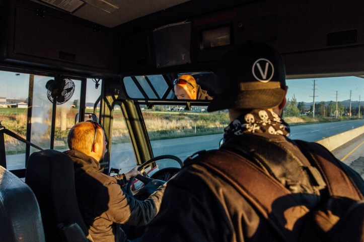 Animal rights activists travel by bus to the Excelsior Hog Farm in Abbotsford, B.C. on April 28, 2019.