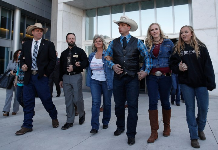 File - In this Dec. 20, 2017, file photo from left, Ammon Bundy, Ryan Payne, Jeanette Finicum, widow of Robert