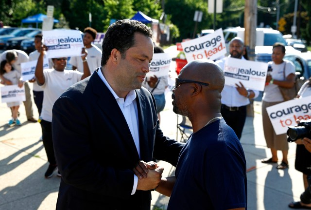 Maryland Democratic gubernatorial candidate Ben Jealous, left, speaks with Alvin Pierce as he greets voters outside a polling place, Tuesday, June 26, 2018, in Baltimore. Jealous and Prince George's County Executive Rushern Baker lead a crowded Democratic primary field to win a nomination to face popular Republican Gov. Larry Hogan in the fall. (AP Photo/Patrick Semansky)