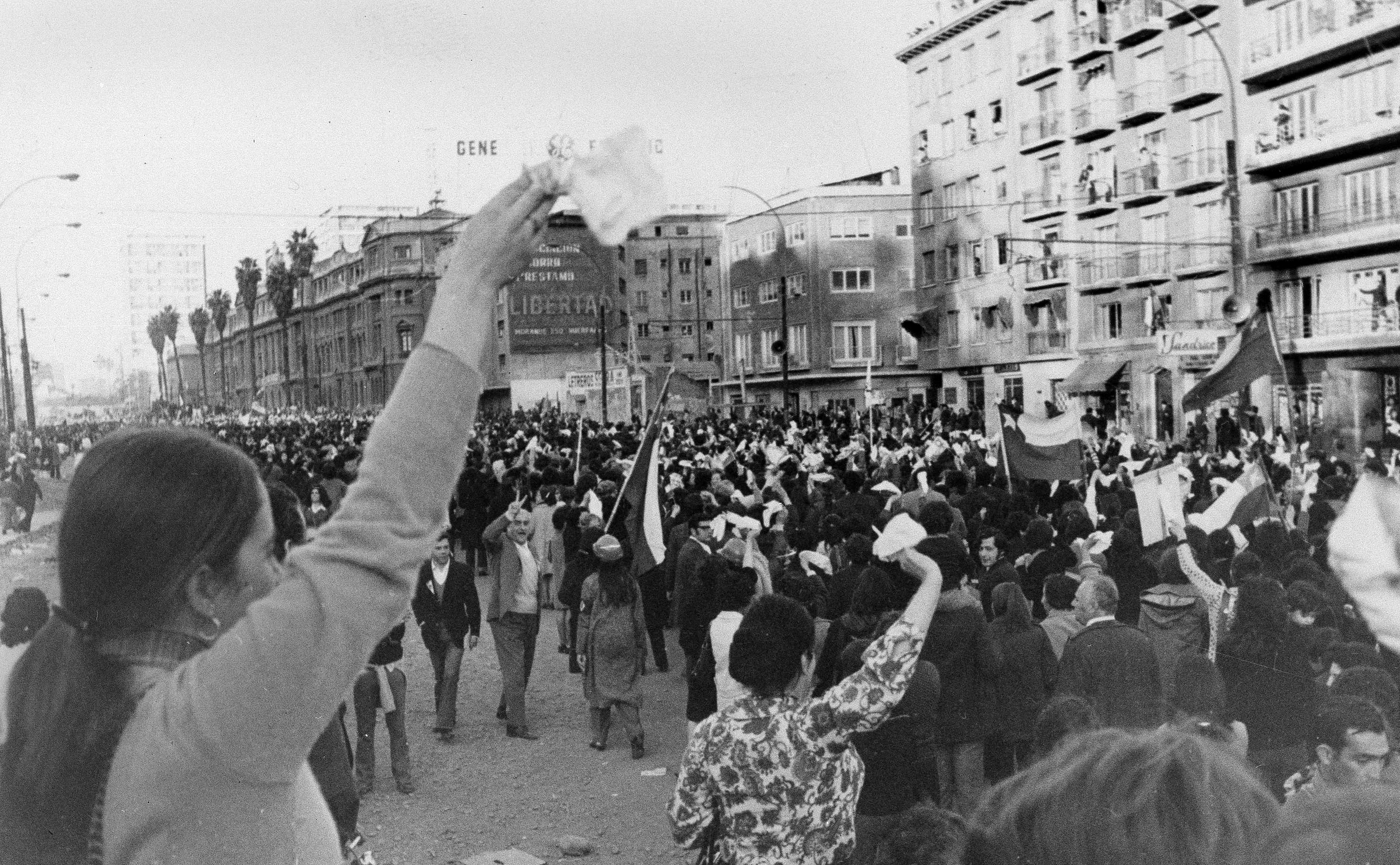 FILE - In this Sept. 5, 1973 file, women wave white handkerchiefs demanding the resignation of President Salvador Allende in Santiago, Chile. Chile marks the 45th anniversary of the coup led by Pinochet overthrowing Allende, on Wednesday, Sept. 11, 2018. (AP Photo, File)