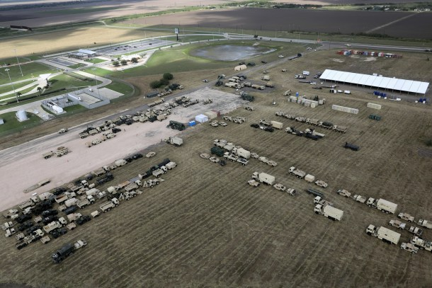 """DONNA, TX - NOVEMBER 07:  U.S. Army vehicles sit parked at a military camp under construction at the U.S.-Mexico border on November 7, 2018 in Donna, Texas. The new forward operating base is located near the Donna-Rio Bravo International Bridge and port of entry between the United States and Mexico. U.S. President Donald Trump ordered troops to the border weeks in advance of the possible arrival of a migrant caravan, which the president has called an """"invasion.""""  (Photo by John Moore/Getty Images)"""