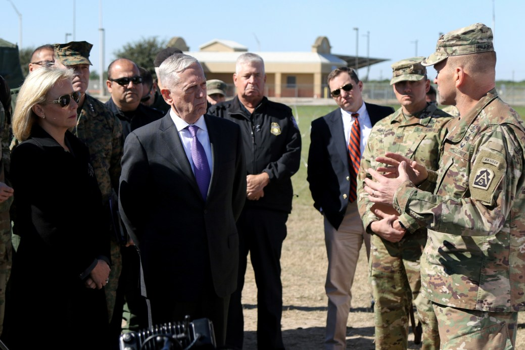 Lieutenant general Jeffrey Buchanan, U.S. Army north commanding general, briefs Kirstjen Nielsen, U.S. Secretary of Homeland Security and James Mattis, U.S. Secretary of Defense at Base Camp Donna in Donna, Texas, U.S., November 14, 2018.   Master Sgt. Jacob Caldwel/U.S. Army/Handout via REUTERS    ATTENTION EDITORS - THIS IMAGE WAS PROVIDED BY A THIRD PARTY. - RC1C8AF3D4F0