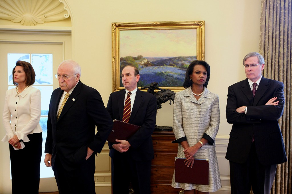 WASHINGTON - OCTOBER 4: Chief of Protocol Nancy Brinker, U.S. Vice President Dick Cheney, Elliott Abrams, Deputy Assistant to the President and Deputy National Security Advisor for Global Democratic Strategy, Secretary of State Condoleezza Rice, Stephen Hadley, Assistant to the President for National Security Affairs stand in the background as U.S. President George W. Bush (R) meets with Saad Hariri, leader of the Lebanese Parliament, in the Oval Office of the White House on October 4, 2007 in Washington, DC. Hariri, the son of the slain former Prime minister of Lebanon, is in Washington for talks about the future of Lebanon. (Photo by Dennis Brack-Pool/Getty Images)
