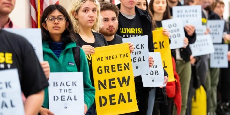 WASHINGTON, DC, UNITED STATES - 2018/12/10: Protesters seen holding placards during the Sunrise Movement protest inside the office of US Representative Nancy Pelosi (D-CA) to advocate that Democrats support the Green New Deal, at the US Capitol in Washington, DC. (Photo by Michael Brochstein/SOPA Images/LightRocket via Getty Images)