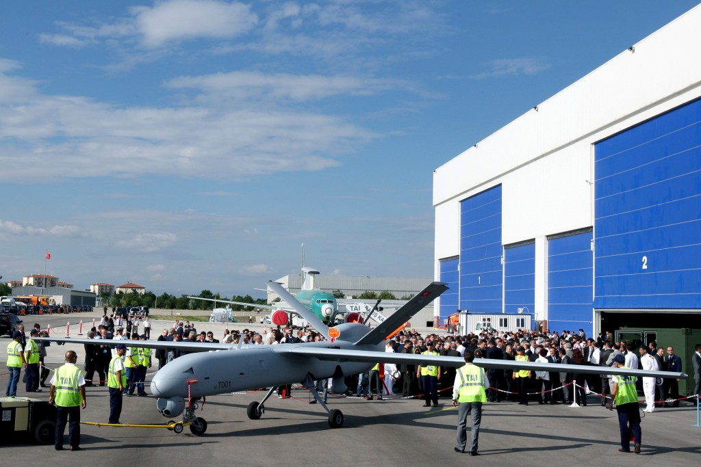 Turkey's first drone airplane called Anka or Phoenix is seen during a roll out ceremony at the TAI - Turkish Aerospace Space Industries Inc., near Ankara, Turkey, Friday, July 16, 2010. Anka, is a surveillance craft able to fly for 24-hour stretches over the rugged mountains where Kurdish rebels are waging a deadly insurgency. (AP Photo/Burhan Ozbilici)