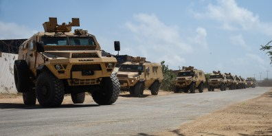 A convoy of armored troop carrying vehicles provided by the U.S. Department of Defense and Department of State drive to the Uganda People's Defence Force compound, Mogadishu International Airport, Somalia, Sept. 25, 2017. Members of U.S. Africa Command and Combined Joint Task Force-Horn of Africa's Mogadishu Coordination Cell assess the needs of the African Union Mission in Somalia and aim to assist them in countering regional violent extremist organizations. (U.S. Air National Guard photo by Tech. Sgt. Andria Allmond)