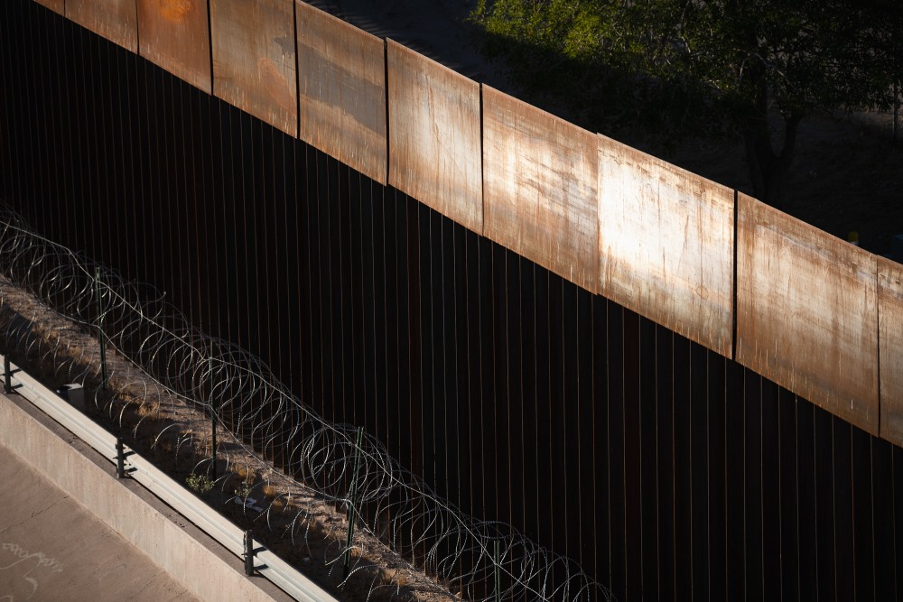 The border fence and razor wire along the Rio Grande between Ciudad Juárez, Mexico and El Paso, Texas. October 29, 2020.