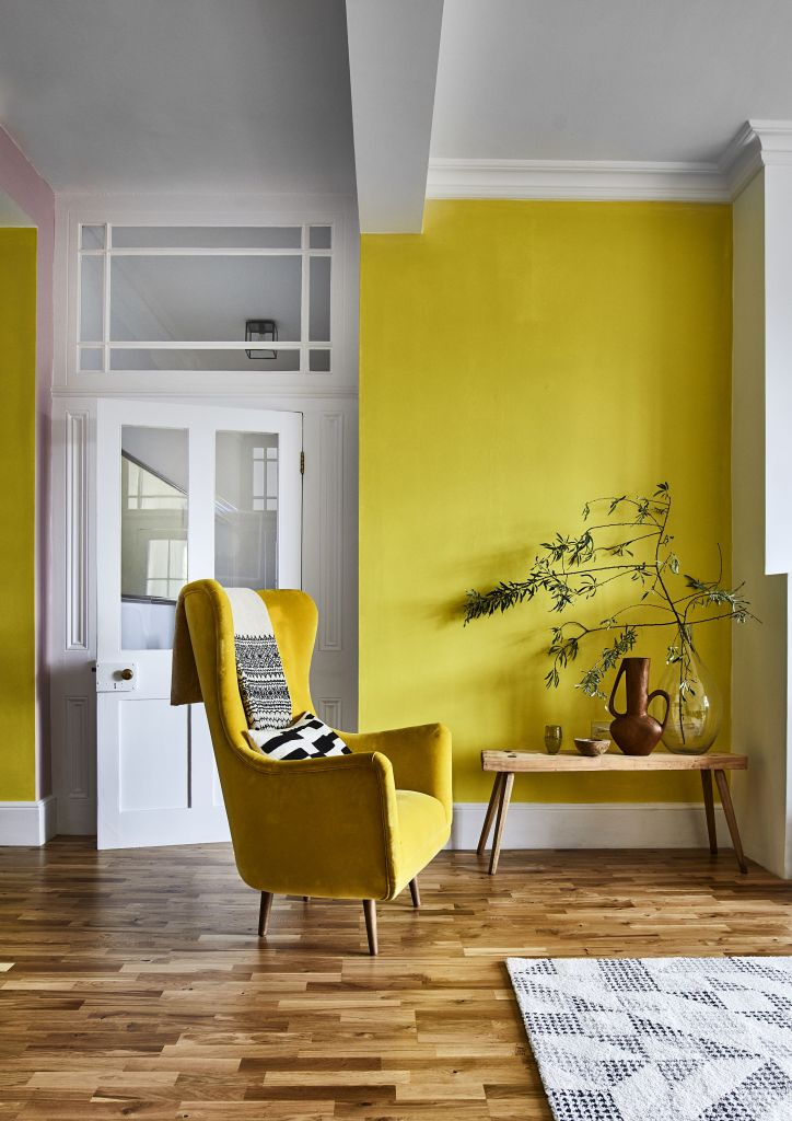 12 Essential Design Tips To Help Update ​Your Home | Colour blocking adds instant visual interest. This bright and sunny living space benefits from using yellow paintwork to create happy vibes.