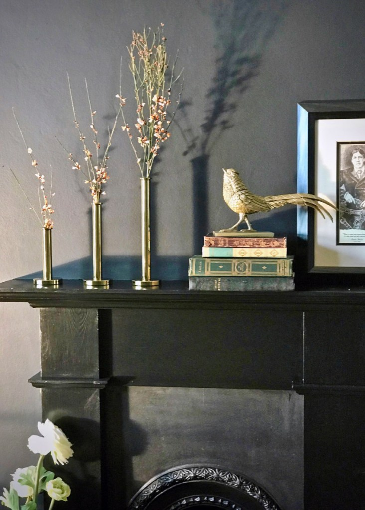 12 Essential Design Tips To Help Update ​Your Home | Old books are used to style and create a fireplace mantle vignette. Great for creating interest, texture to a space.