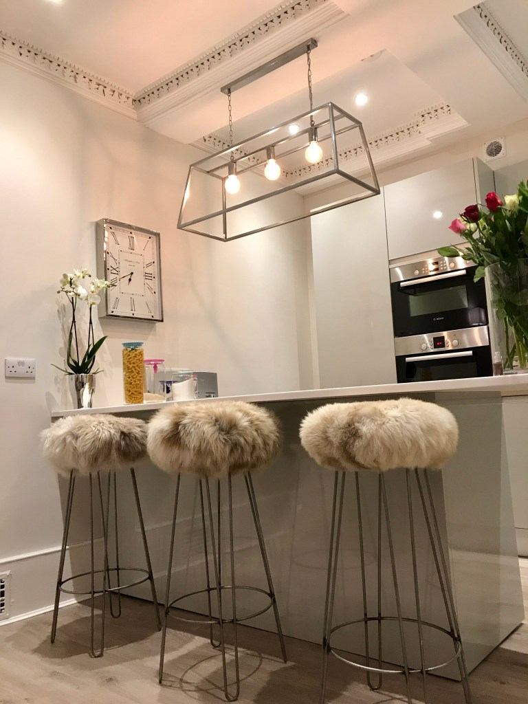 Baa Stool - Handmade Sustainable Sheepskin Designs |Baa Stools range of kitchen bar stools offer your kitchen spaces tactile textures. They have a removable practical sheepskin cover.