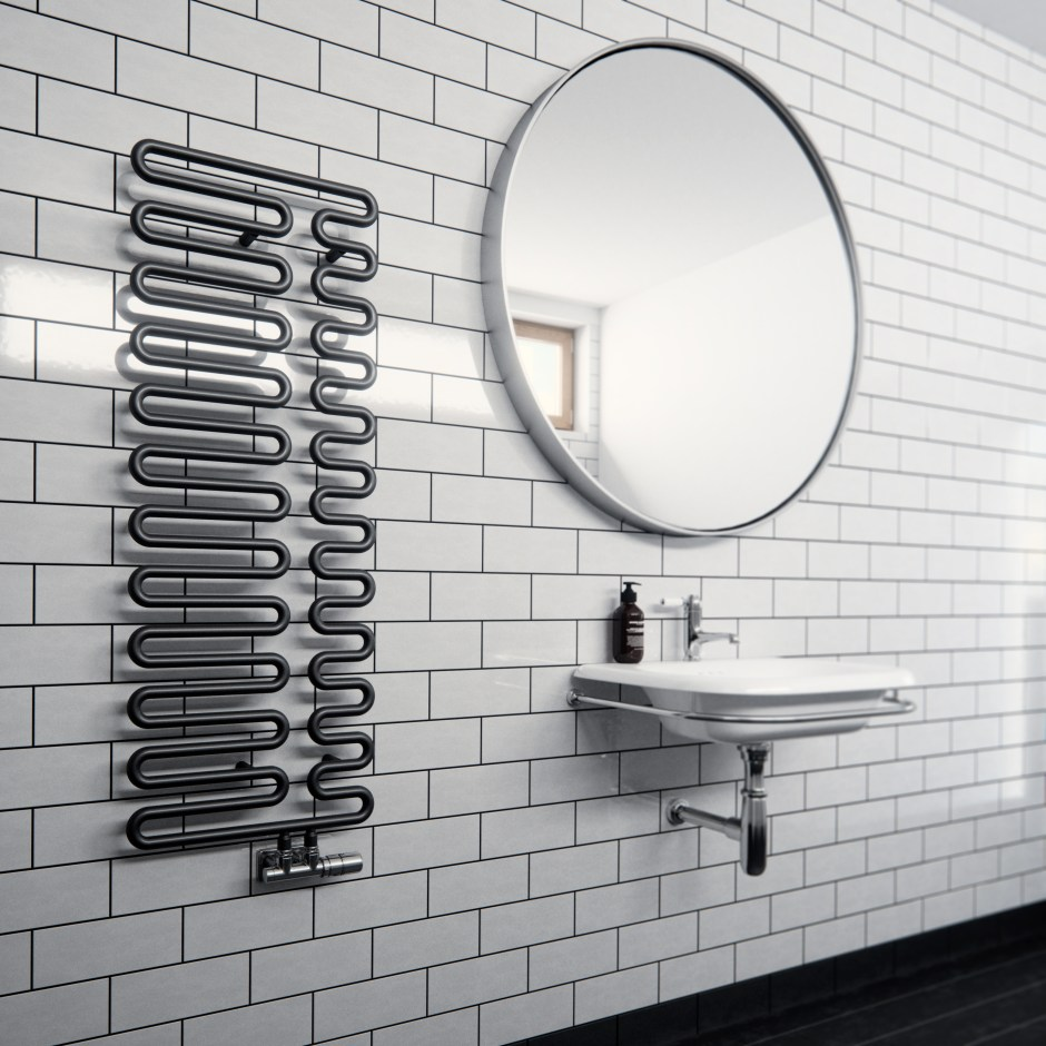 Black & White Bathrooms - The Ongoing Trend | Black statement radiators are on trend this year for our bathroom spaces. This one is from Frontline Bathrooms