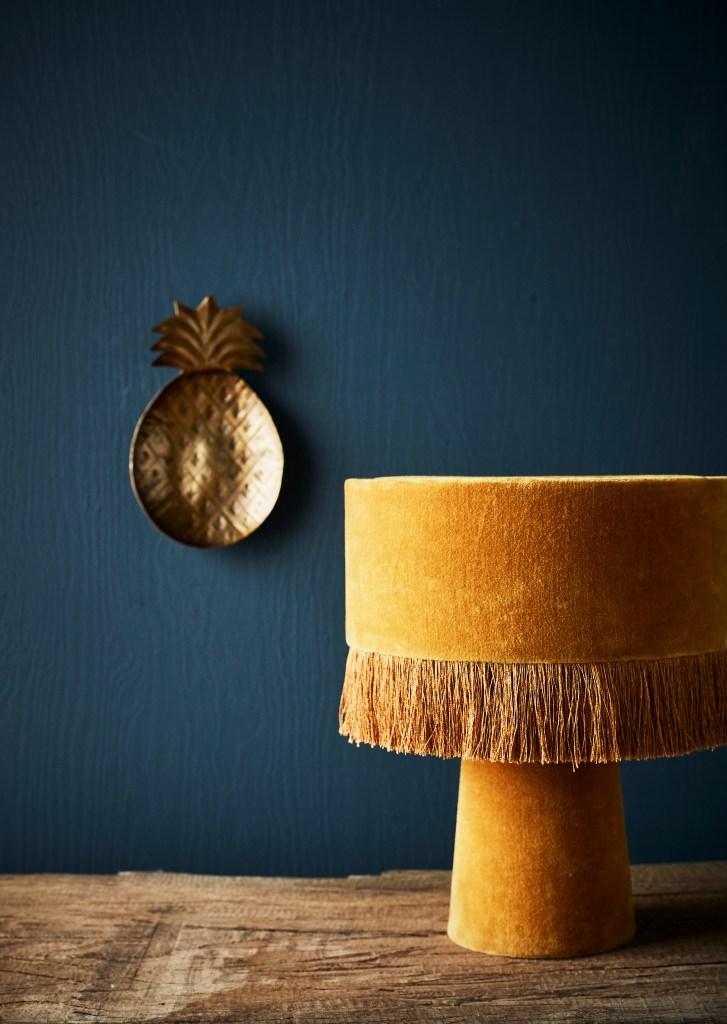 The Fringe Trend For Your Homes | Heavily adorned velvet and fringed yellow mustard velvet table lamp.