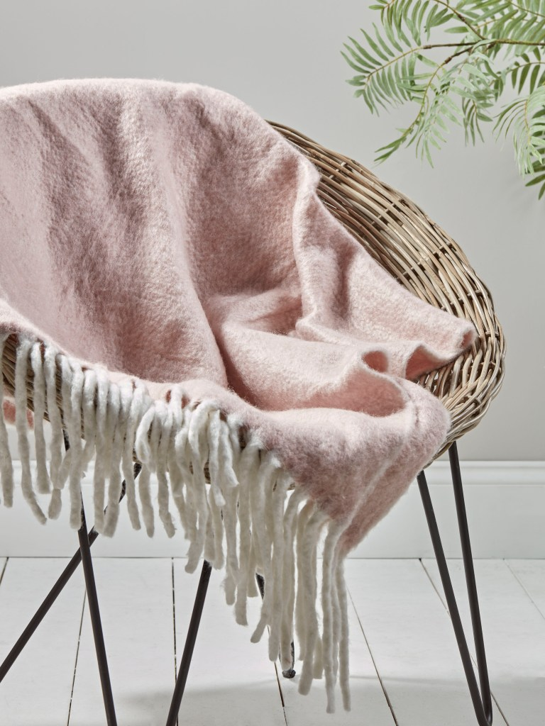 The Fringe Trend For Your Homes | Soft fringe throw in blush from Cox and Cox