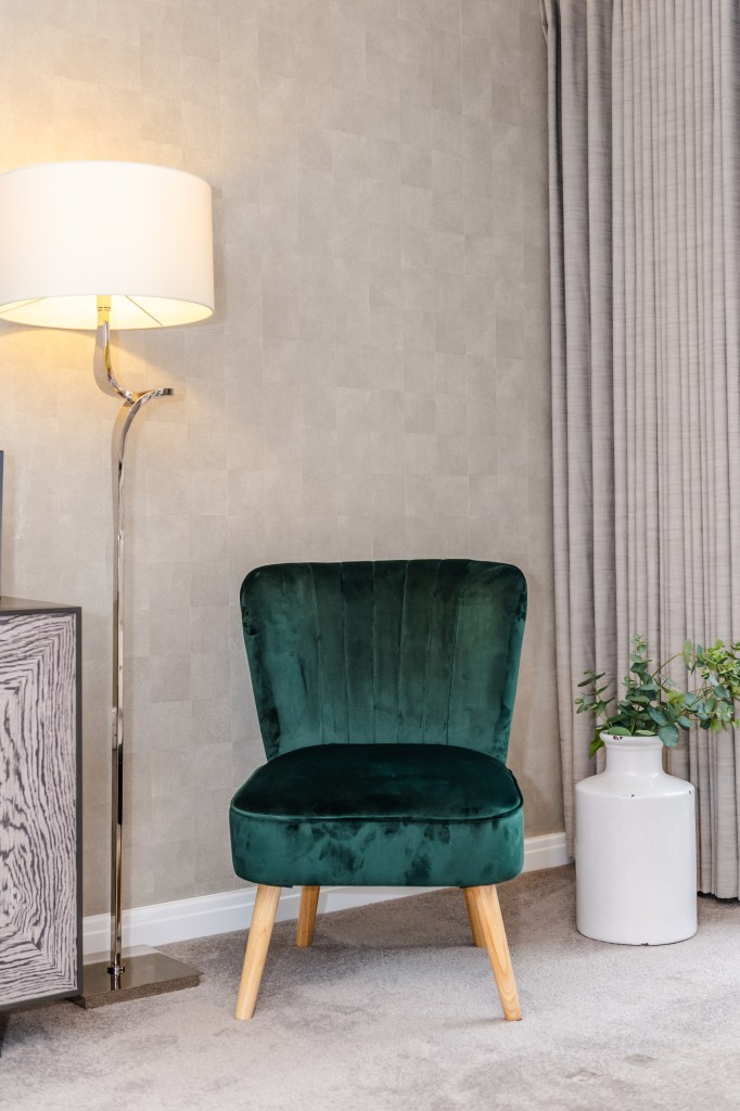 Affordable On-Trend ​Velvet Furniture From Sue Ryder | Emerald green velvet oyster chair from Sue Ryder. Part of their affordable velvet furniture collection with all profits going towards the Sue Ryder charity.