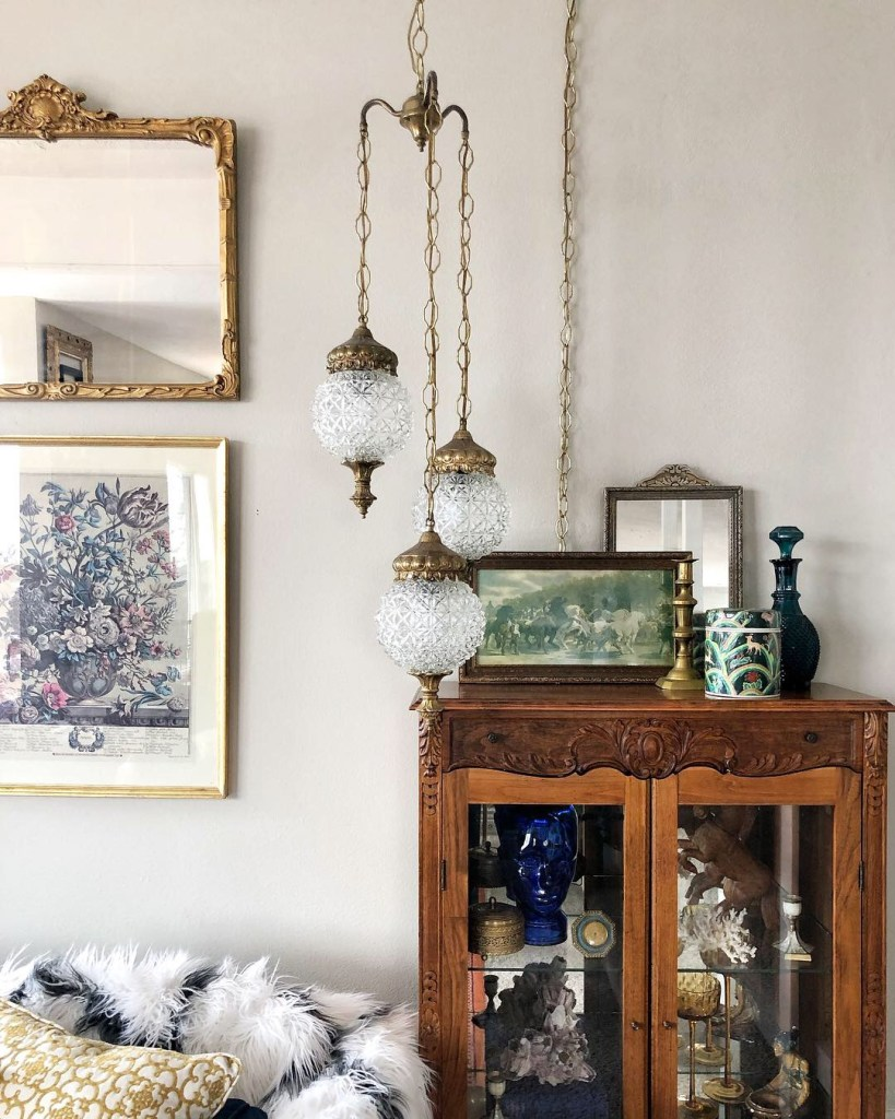 An Eclectic '70s Home Filled With Vintage Finds - Jenasie Earl | Vintage swag lighting and other eclectic decor create a unique and characterful living room.
