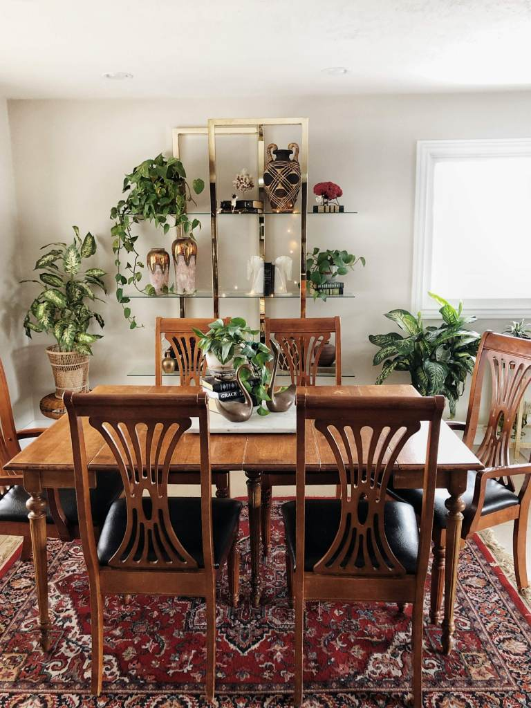 An Eclectic '70s Home Filled With Vintage Finds - Jenasie Earl | dining room filled with vintage furniture and eclectic vintage decor to create a unique and characterful home.