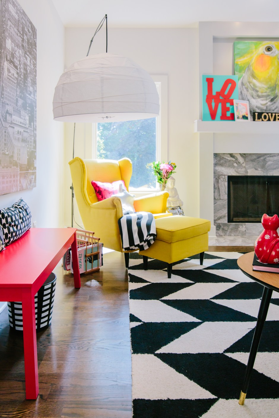The Creative, Bold & Colourful Home of Paola Roder | Living room seating area using vibrant colour palette and bold pattern to create visual energy and an element of fun.