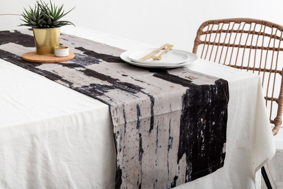 Ruth Holly designs home accessories such as this table runner which encompass earthy tones, patterns and organic markings from nature itself.