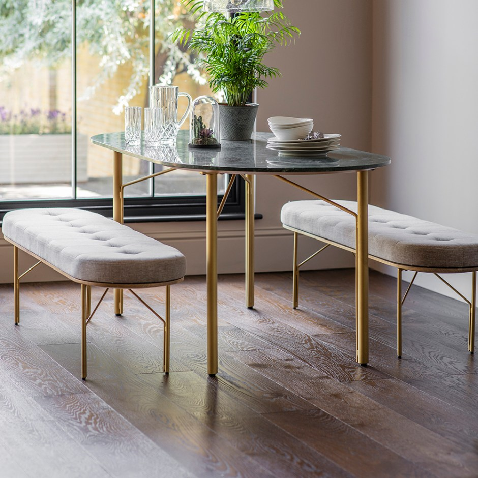 Benches provide a feeling of more space as your eye isn't obstructed by chair backs and allows your table to take center stage.  You might want to consider opting for a padded upholstered version if you anticipate long dinner parties or perhaps working at the table.