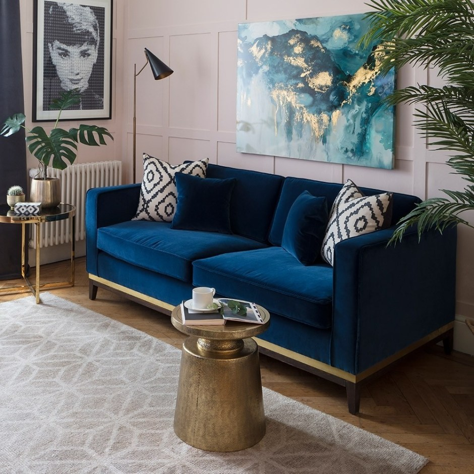 How To Use Classic Blue - Pantone's Colour Of The Year 2020 | Classic blue velvet sofa pairs with pink panelled walls in this living room design.