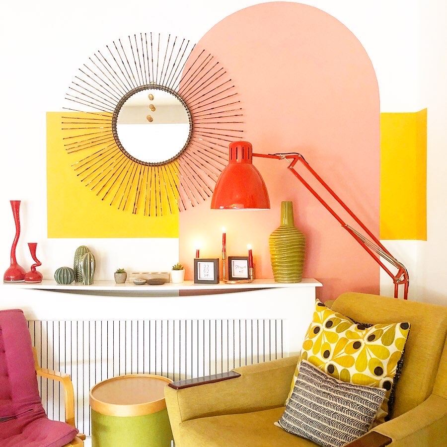 How To Use Paint Creatively In Your Home | Simple asymmetrical colour blocking twitht paint o create a feature to a seating area to add interest to this fun retro styled home