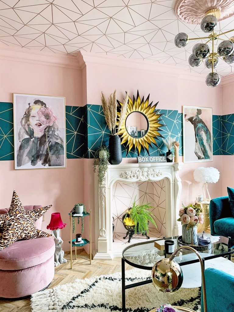 The Glamorous Colourful & Pattern Filled Home of Cara Baker | Pink and teal living room that uses patterned wallpaper to the ceiling (fifth wall) to create interest and the unexpected.