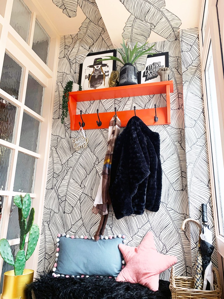 The Glamorous Colourful & Pattern Filled Home of Cara Baker | Using the fifth wall (ceiling to add pattern and interest by using wallpaper. Accessories and textures together with vibrant pops of colour make this entrance fun and unique