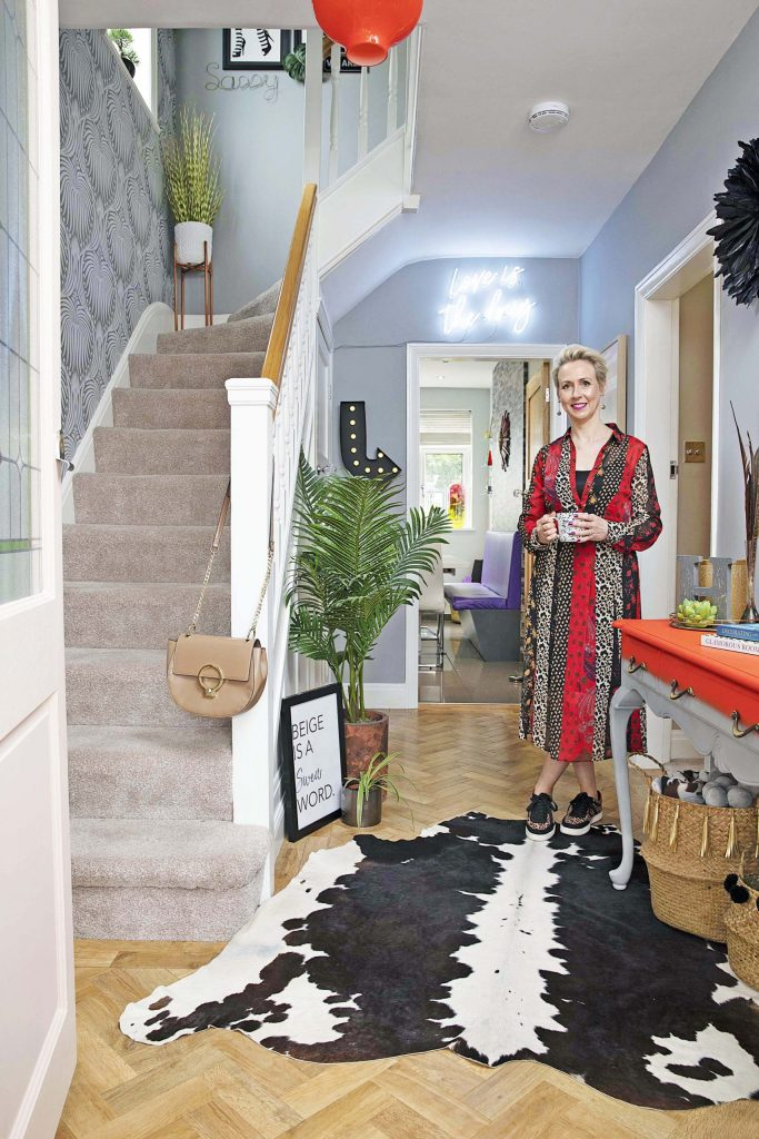 The Glamorous Colourful & Pattern Filled Home of Cara Baker | Cara Baker in her eclectic entrance hallway.