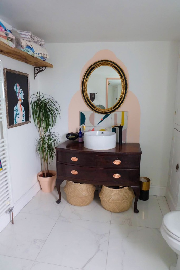 The Creative Eclectic Home of Gold Leaf Queen - Lara Bezzina - eclectic bathroom upcycled furniture wash basin and colour blocked walls