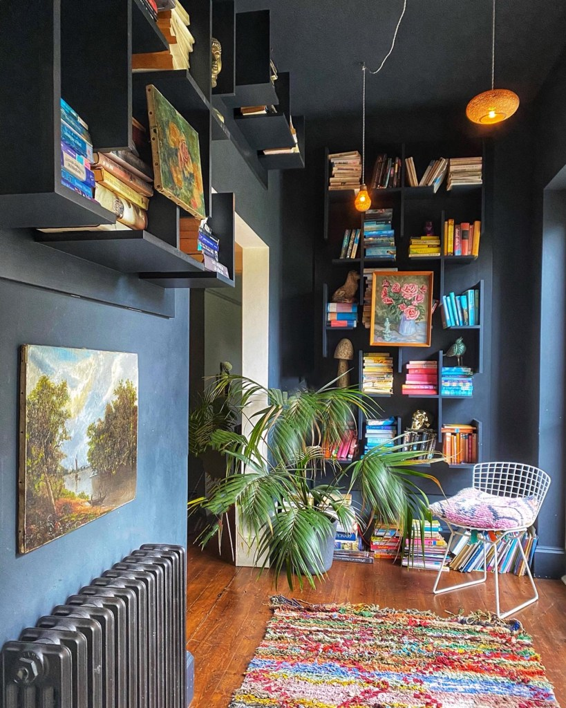 Arts & Crafts House uses paint to create a a seamless backdrop to showcase art and book collections