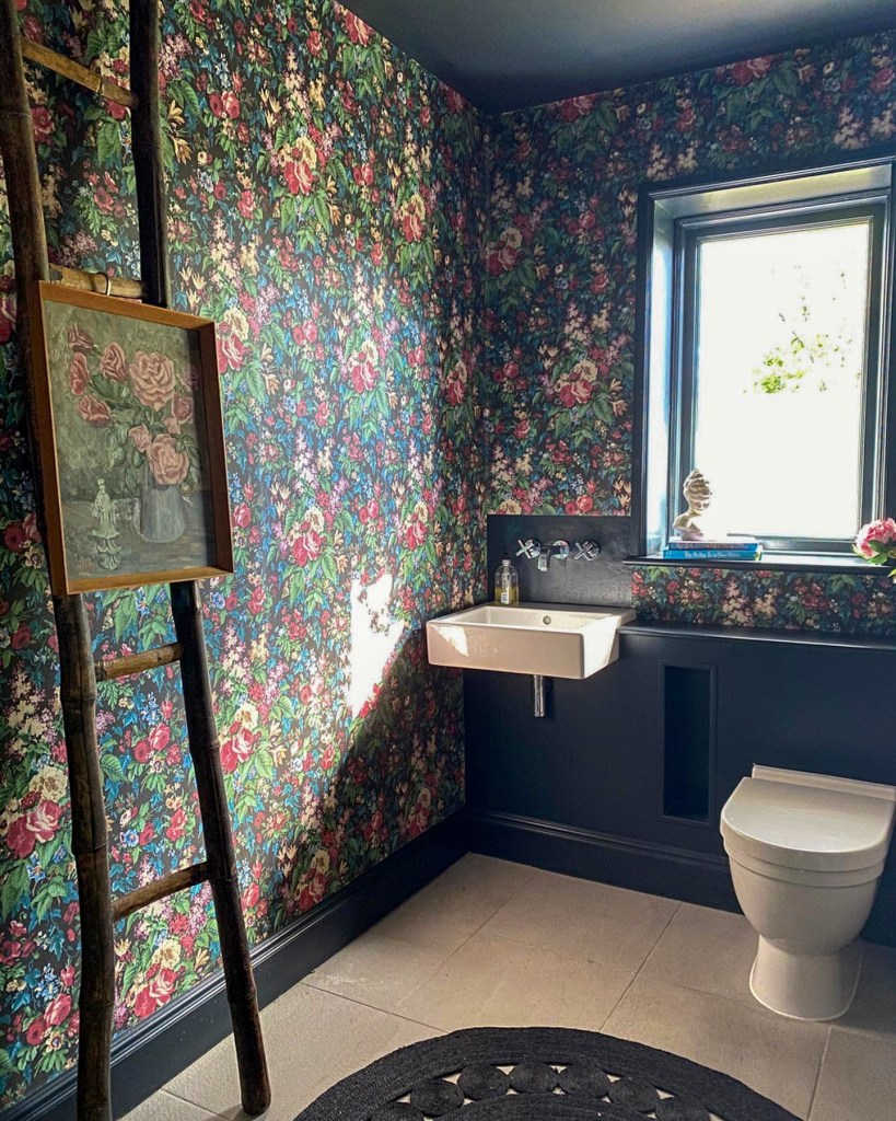Arts & Crafts home - cloakroom decorated with Faded Glamour Noir Floral wallpaper from Woodchip & Magnolia.
