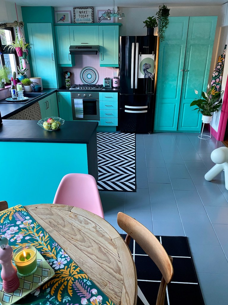Aqua painted up-cycled kitchen units with monochrome details and painted floor. Colour & Pattern Filled Eclectic Home - Saara McLoughlin