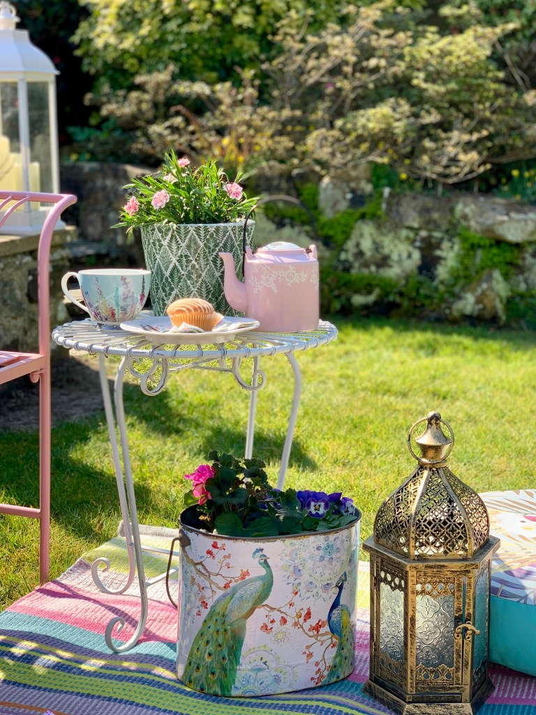 Easy Styling Tips For Your Garden Seating Areas - Decorative planters add interest and colour