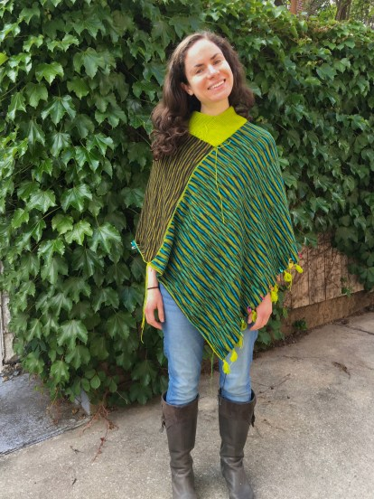 front view of one face of unfinished machine knit poncho