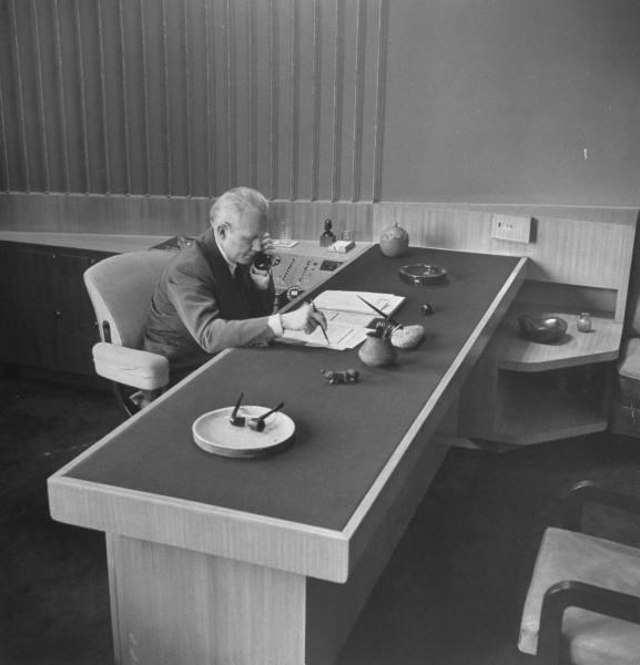 CBS President Frank Stanton sitting at his desk - 1948