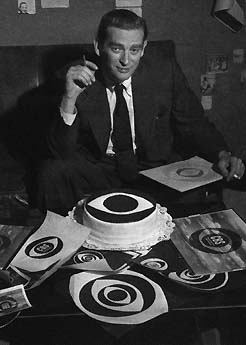 "Designer William Golden with his new ""eye design"" logo for CBS which was influence by ""Shaker Design"""