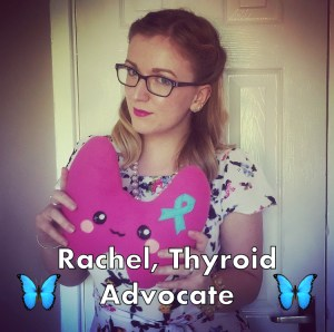 Rachel, holding a thyroid plushie.