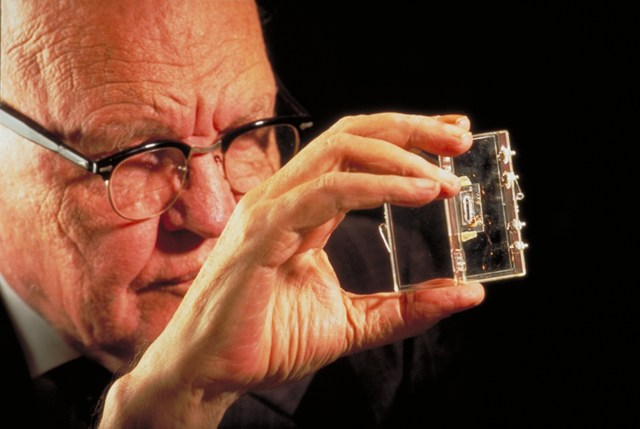 Jack Kilby is holding the first integrated circuit