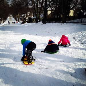The race is on! Charlie and Gigi st the summit of Mount Vernon's Main Street sledding hill.