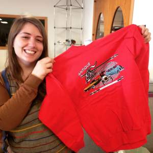 Becky, holds up one of the many shirts you can purchase at the museum. I'm hopping there's going to be summer line of