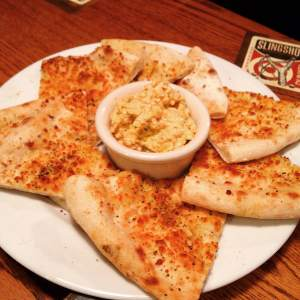 Backpocket Brewing is also known for some great food too. My favorite item is the spicy beer cheese dip with flatbread. RAGBRAI'ers will need the necessary carbs that get served on a plate and pint glass.  s://www.facebook.com/BackpocketBrewing