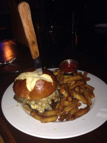 Use your hands anyway! One of the areas best burgers and some fresh cut french fries to go with it! This is the one and only Davenport Burger. It comes with Bleu Cheese Crumbles Bourbon Glazed Onions Smoky Bacon Crumbles Horseradish and all on a Pretzel Roll. https://www.facebook.com/meandbillykitchenandbar?fref=ts