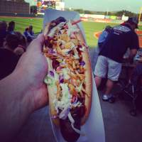 At Veterans Memorial Stadium in Cedar Rapids. Grilled foot-long with chili, coleslaw, and crispy fried onions. And now me eat! NOM..NOM...NOM!