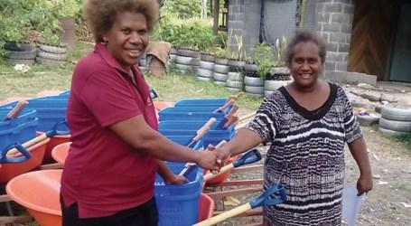 Farmers receive farming tools