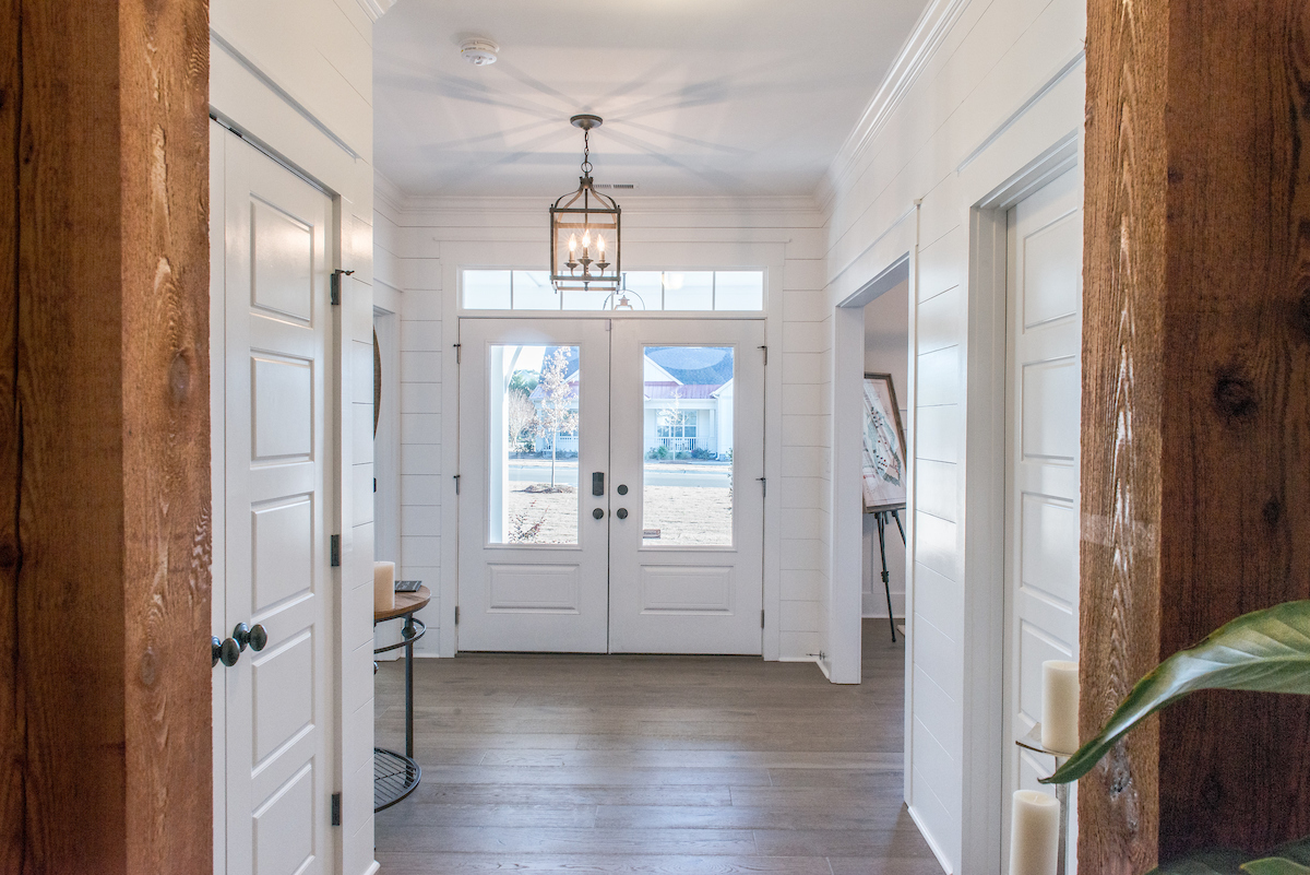 Shiplap entry hall with rustic wood columns
