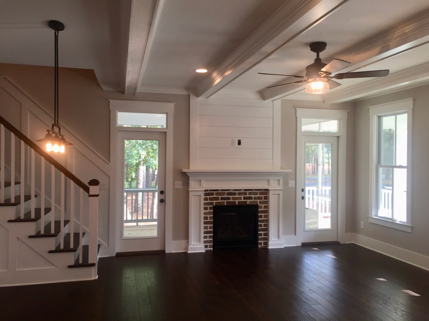 Shiplap accent over brick fireplace