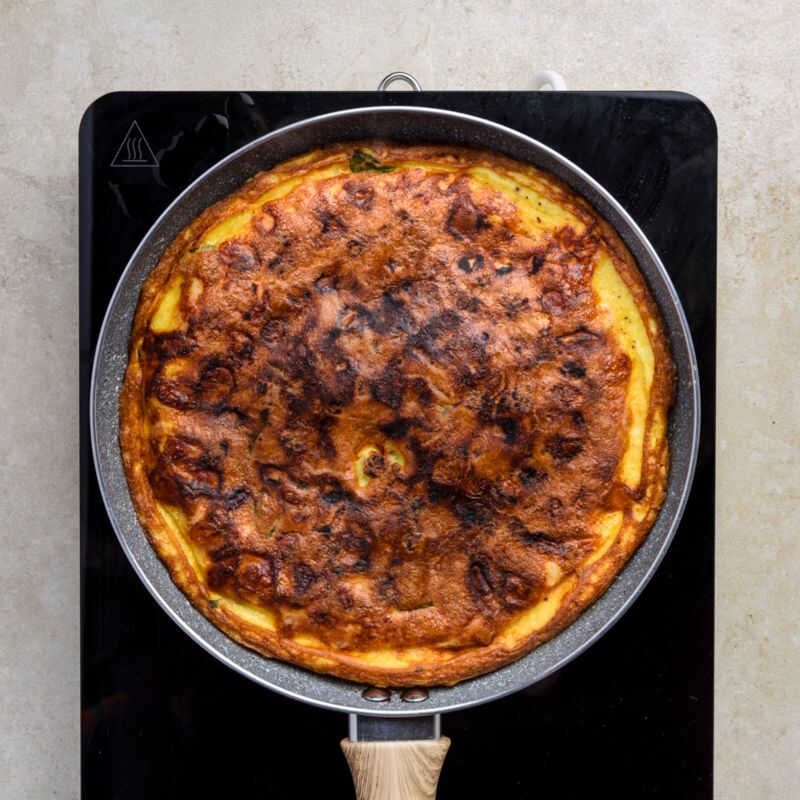 flip the frittata, one of the most famous italian recipes, and let it cook for another 10 minutes
